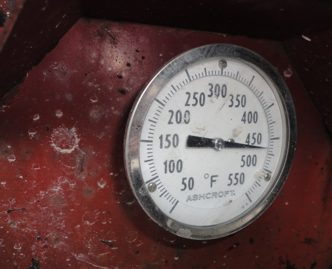 temperature gauge on tar boiler at flat roofing job site